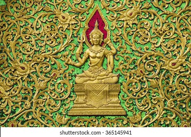 public gold buddha carved at temple , Chiang Mai  , Thailand / Narayana