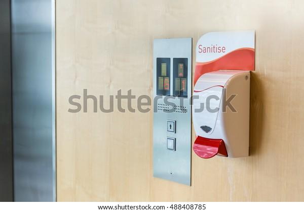 Public hand sanitizer next to elevator in hospital
