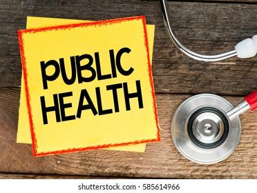 Public health. Medicine concept / Yellow Paper sticker with inscription public health and stethoscope, medicine concept