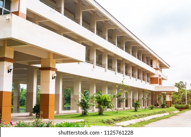 Public high school building. View of secondary or primary school architecture with green lawn with playground in Thailand, education concept