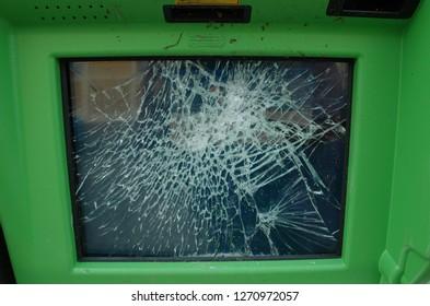 A public info screen broken by a hooligan