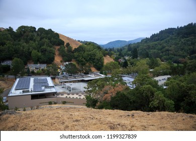 Public junior high school with solar panels on roof in Northern California hills