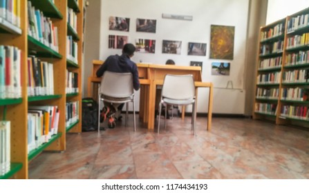 Public Library Bookshelf with Book and Music CDs with University Students Preparing Exams in Milan,Italy-September 2018
