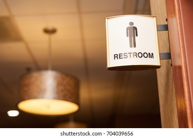 Public men restroom sign close up image