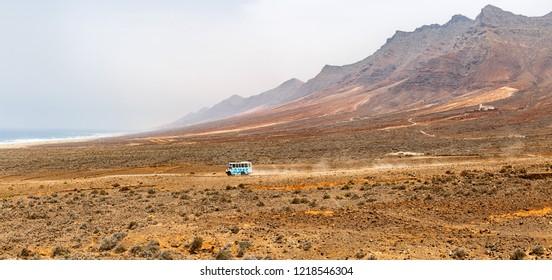 Public Mini-Bus crossing Cofete Beach in Fuerteventura, Canary Islands