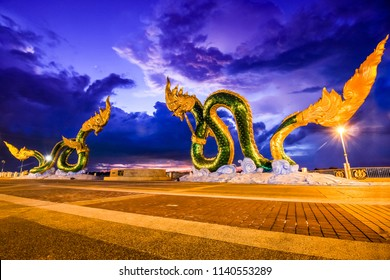 Public open space Phaya naga The Dragons Of Thailand Walking Street in Nongkhai under storm clouds twilight sky with blurred clouds and tree by the wind.HDR Landscape Tone.