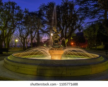 Public park fountain at nighttime in Cortona, Tuscany Italy