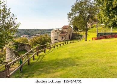 Public park and the ruins of the medieval Rocca Borromea of Arona above the city, Arona, Piedmont, Italy