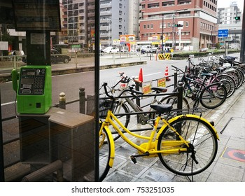 Public phone booth and bicycle parking space in Osaka, Japan taken on 6th April, 2017