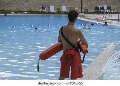 Public pool's lifeguard watching swimmers (Series 1 of 7)