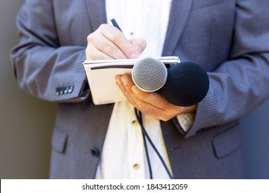 Public relation (PR) officer working at press conference or media event