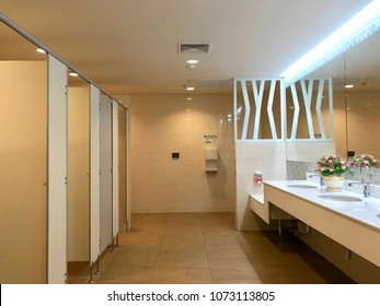 Public restroom design, row of toilet made of wood partition