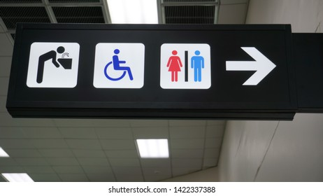 public restroom or toilet signs over head