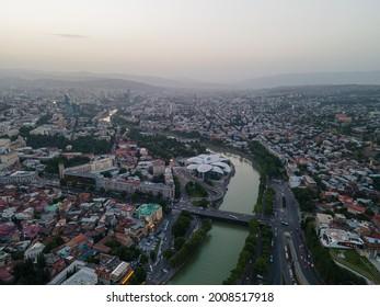 Public revenue and Baratashvili Bridge in the center of Tbilisi. Aerial view of beautiful cityscape over Kura river - Shutterstock ID 2008517918