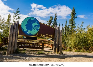 """A public sign marks the Arctic Circle on the only road to cross it in the United States, the Dalton Highway or """"Haul Road"""" in northern Alaska"""