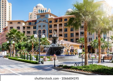 Public square with water fountain on the Medina Centrale district at the Pearl in Doha, Qatar