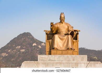 Public Statue of King Sejong, The Great King of South Korea, with Mountain Background in Gwanghwamun Square in Seoul, South Korea.