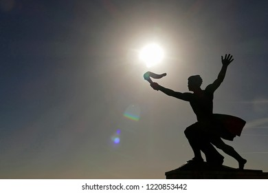 Public statue of the Storchbearer on top of Gellert hill in Budapest, Hungary (with the sun)