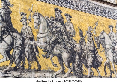 Public street view of the largest porcelain artwork in the world Furstenzug - Procession of Princess in Dresden, Germany, mural of a mounted procession of Saxony rulers