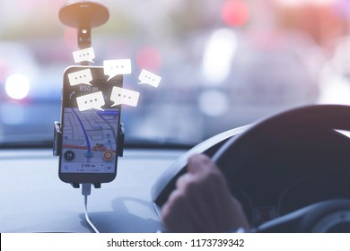 Public taxi, Pick-up request concept, An unidentified man is driving public taxi, with pick-up request message showing on smart phone screen.