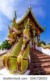The public temples  decorated with Dragon statues or Naga staircase in Thailand  with blue sky background.