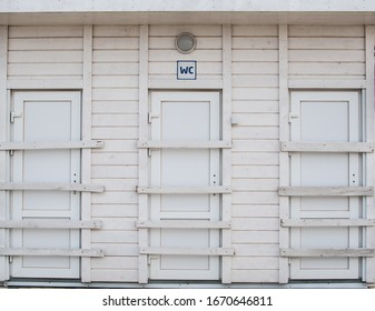 Public toilet on the beach, toilet for men and women on the street, wooden building of a public toilet,
