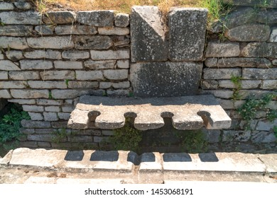 Public toilets in historical ancient city Sardes (Sardis), Manisa, Turkey.