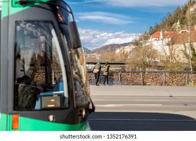 Public train of the Austrian city Graz at a bridge over the River Mur at the Schlossberg