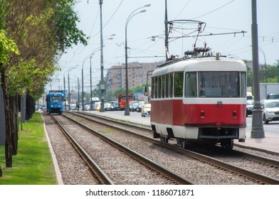 Public tram traffic on summer city street