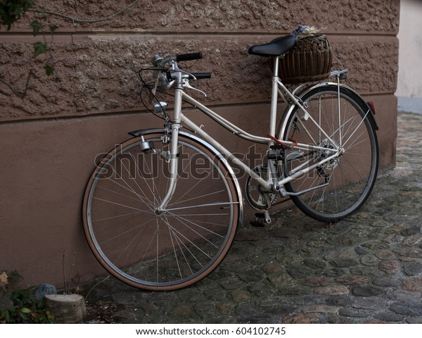Public transport, bicycle parked at the wall