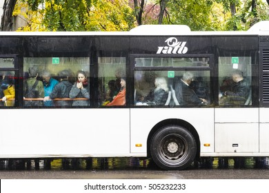 Public transport bus/Image of a bus crowded with people in a station in Bucharest on a rainy autumn day. Bucharest, Romania, October 26, 2016.