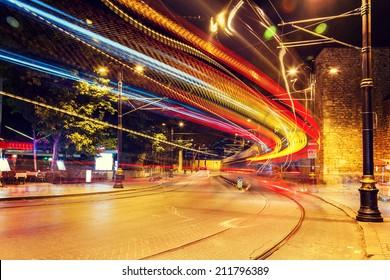 public transport metropolis, traffic and blurry lights tram at night, Istanbul, Turkey