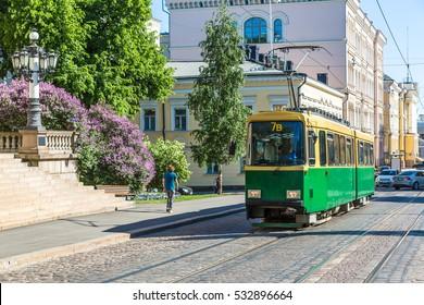 Public transport, retro tram in Helsinki in a beautiful summer day, Finland