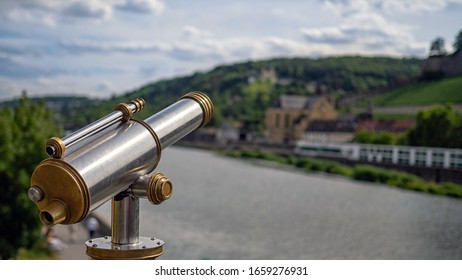 Public viewing telescope and defocused view along the River Main in Germany