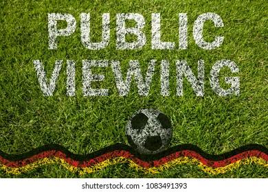 Public viewing written on soccer meadow