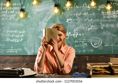 publicist woman hold book at school. publicist search information in book