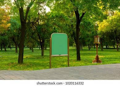 Publicity board in the park, autumnal background