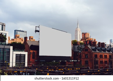 Publicity mock up billboard on exterior of modern building in urban area. Template for paste advertising or commercial information, blank billboard with copy space on facade in city