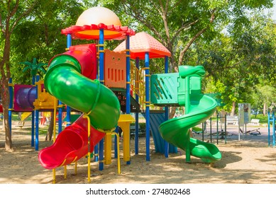 Public's playground in city. Colorful playground on yard in the park. Park with set of modern kids playground background. children Stairs Slides equipment. Blur playground in park abstract background.