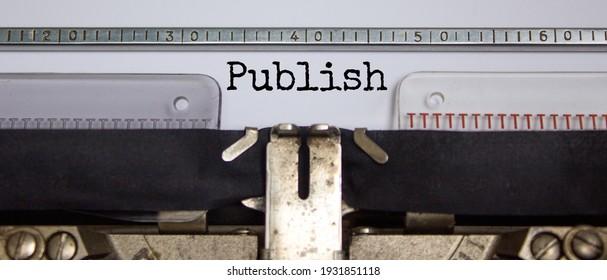 Publish symbol. The word 'publish' typed on retro typewriter. Business, publish concept. Beautiful background.