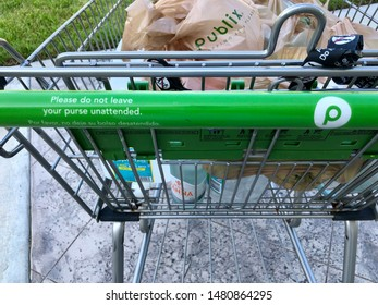 Publix shopping cart outside of local supermarket. The Saint Augustine, Florida USA. August 14, 2019