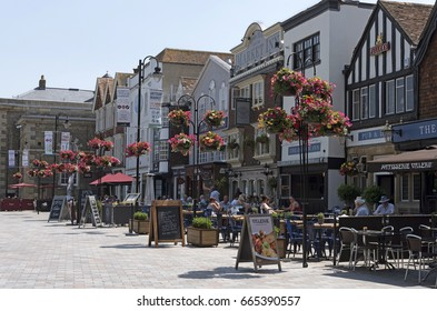 Pubs and restaurants on the Market Place in the historic city of Salisbury Wiltshire England UK. June 2017