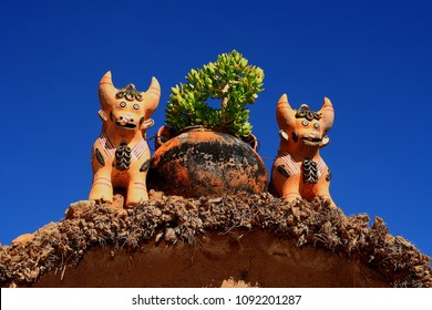 Pucara bulls, are placed on the roofs of houses to protect. Artesania de Puno, Peru.
