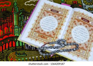 Puchong, Malaysia - April 09, 2019; Holy Quran and tasbih or rosary on the praying mat / sajadah. Selective focus.
