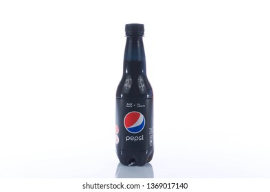 Puchong, Malaysia - April 14, 2019; Pepsi drinks in the bottle on the white background. Pepsi is a carbonate soft drink that is produced and manufactured by PepsiCo. Selective focus.