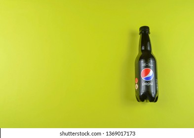 Puchong, Malaysia - April 14, 2019; Pepsi drinks in the bottle on the  yellow background. Pepsi is a carbonate soft drink that is produced and manufactured by PepsiCo. Selective focus.