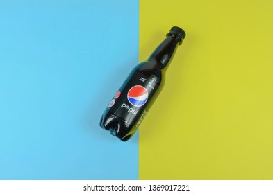 Puchong, Malaysia - April 14, 2019; Pepsi drinks in the bottle on the blue and yellow background. Pepsi is a carbonate soft drink that is produced and manufactured by PepsiCo. Selective focus.