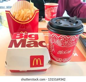 Puchong, Malaysia - February 17, 2019; McDonald's Big Mac hamburger menu, French Fries and coffee. Selective focus.
