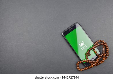"""Puchong, Malaysia - July 05, 2019; Flatlay concept for Muslim Pro icon apps for muslim. Very popular apps for reading quran, performing pray or """"solah"""" and qibla direction. Best islamic apps in 2019."""