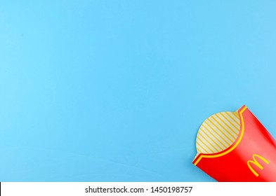 Puchong, Malaysia - July 14, 2019; McDonald's French fries box on blue background. McDonald's Corporation is the world's largest fast food restaurant.